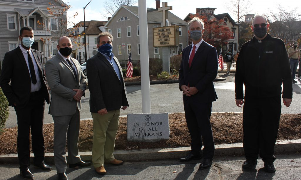 Pictured from left to right: Bruno Freire, Assistant Branch Manager, Nicolas DeSena, Branch Manager, Glen Chretien, Investment Advisor representing Mechanics Investment Group, New Bedford Mayor, Jon Mitchell, and Father Mike Racine of St. Lawrence Martyr Church.