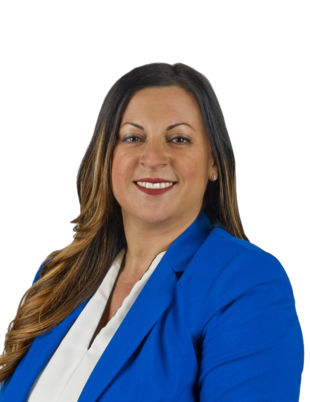 Branch manager Sandra Cordoniz posing for headshot smiling in blue jacket